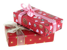 Presents. Two gift boxes which have been tied up by tapes with bows, isolated on a white background Stock Photo
