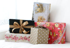 Presents. A collection of presents or gifts for a wedding or special occasion displayed on a sofa Stock Photos