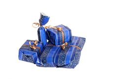 Presents. Some presents in blue paper with isolated white background Stock Photo