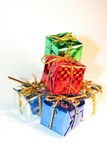 Presents 5. Five presents tied with silver ribbon Stock Photos