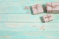 Gift boxes wrapped kraft paper tied with twine and paper snowflake and tied with twine. with copy space. Presents for any holiday concept. Border of decorative Stock Photos