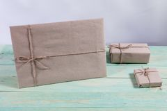 Gift boxes wrapped kraft paper tied with twine and paper snowflake and tied with twine. with copy space. Presents for any holiday concept. Border of decorative Stock Image