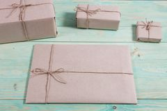 Gift boxes wrapped kraft paper tied with twine and paper snowflake and tied with twine. with copy space. Presents for any holiday concept. Border of decorative Royalty Free Stock Images