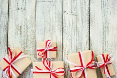 Presents for any holiday concept. Gift boxes frame, top view with copy space on wood table background Stock Photography