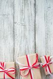 Presents for any holiday concept. Gift boxes frame, top view with copy space on wood table background Royalty Free Stock Images