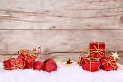 Presents and apples in the snow, space for text Stock Images