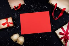 Presents and bags on black background stock photography