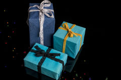 Presents on black from high angle with lights Stock Images