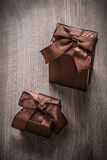 Presents boxed in glittery paper with brown ribbons top view Royalty Free Stock Images