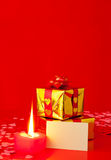 Presents and burning candle with blank card Royalty Free Stock Photography