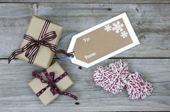 Presents By To: From: Tag On Wood Table Stock Photography