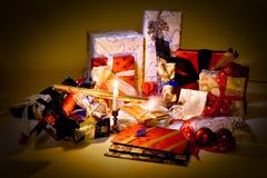 Presents and candle light Royalty Free Stock Photography