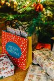 Presents And Chocolate Candies Waiting To Be Opened Royalty Free Stock Image