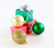 Presents with Christmas balls Royalty Free Stock Photos