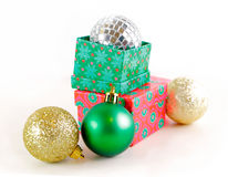 Presents with Christmas balls Royalty Free Stock Image