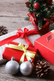Presents with christmas decor on wooden surface - Series 6 Stock Images