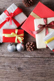 Presents with christmas decor on wooden surface - Series 9 Stock Photos