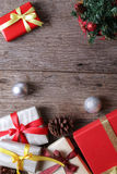 Presents with christmas decor on wooden surface - Series 12 Stock Photography
