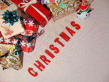 Presents with christmas written underneath. In red Stock Image