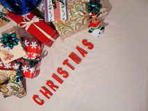 Presents with christmas written underneath. In red Royalty Free Stock Image