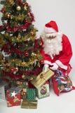 Presents for everyone. Santa Claus and his Christmas tree Royalty Free Stock Photo