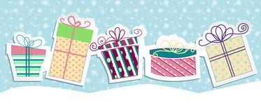 Presents. Five presents on a blue snow background with ribbon Stock Photography