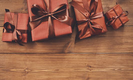Presents in gift boxes on wood background with copy space Stock Photography