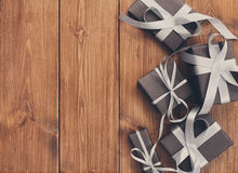Presents in gift boxes on wood frame background Royalty Free Stock Photos