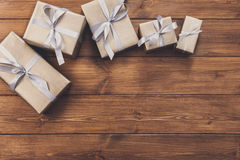 Presents in gift boxes on wood frame background Royalty Free Stock Photo