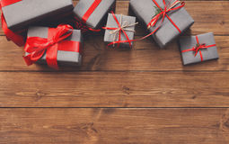 Presents in gift boxes on wood frame background Stock Photo