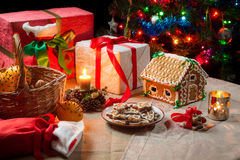 Presents and gingerbread cookies Stock Images