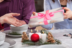 Presents giving during christmas eve Stock Image