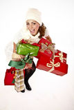 Presents Are Here. Cute Cheerful Woman Holding A Bunch Of Gifts Royalty Free Stock Image