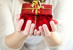Presents. Image of presents with hand with white background Royalty Free Stock Image