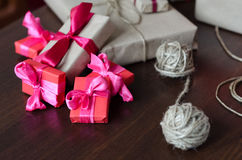 Presents in kraft paper with red ribbons Stock Image