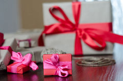 Presents in kraft paper with red ribbons royalty free stock images