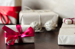 Presents in kraft paper with red ribbons Stock Photography