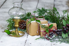 Presents and lantern on snow covered porch Royalty Free Stock Photos