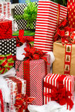 Presents. Large presents wrapped in colorful papers with bows in a pile ready for Christmas Stock Image