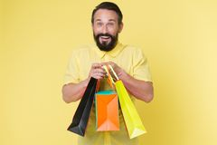 Presents make life more interesting. Man mature bearded cheerful face holds shopping bags. Man got unexpectable gifts. Guy touched by attention and gifts for royalty free stock photo