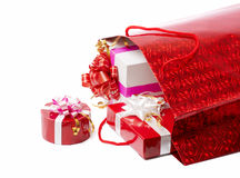 The presents in the package. The presents in the red package stock image