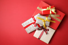 Presents on red background Royalty Free Stock Image