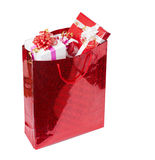 The presents in the red package. The presents in the big red package stock photo