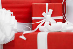 Presents with red packaging and white bows Royalty Free Stock Photos