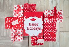 Presents in red and white wrapping paper Stock Photography