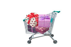 Presents ribbon gift box in shopping trolley cart. Isolated on white background Royalty Free Stock Images