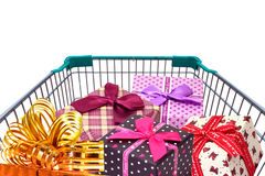 Presents ribbon gift box in shopping trolley cart on white background. Presents ribbon gift box in shopping trolley cart isolated on white background Royalty Free Stock Images
