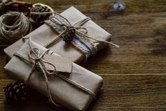 Presents in rustic wrap, wood background Stock Images