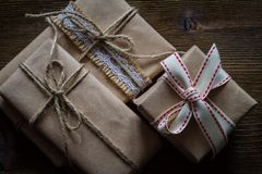 Presents in rustic wrap, wood background Stock Photo
