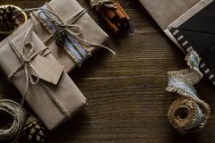 Presents in rustic wrap, wood background Royalty Free Stock Images